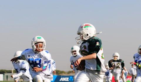 Austinite Exports Football to China